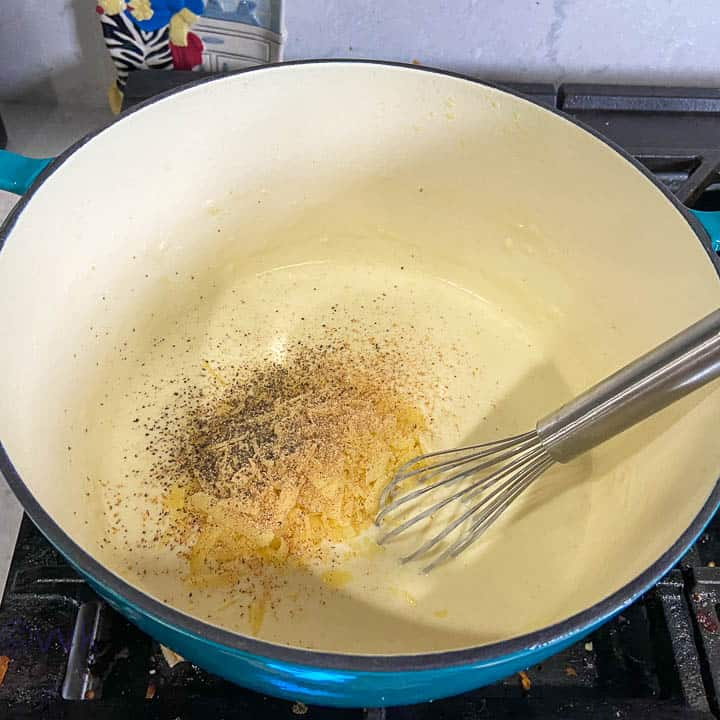 adding remaining cheese and spices