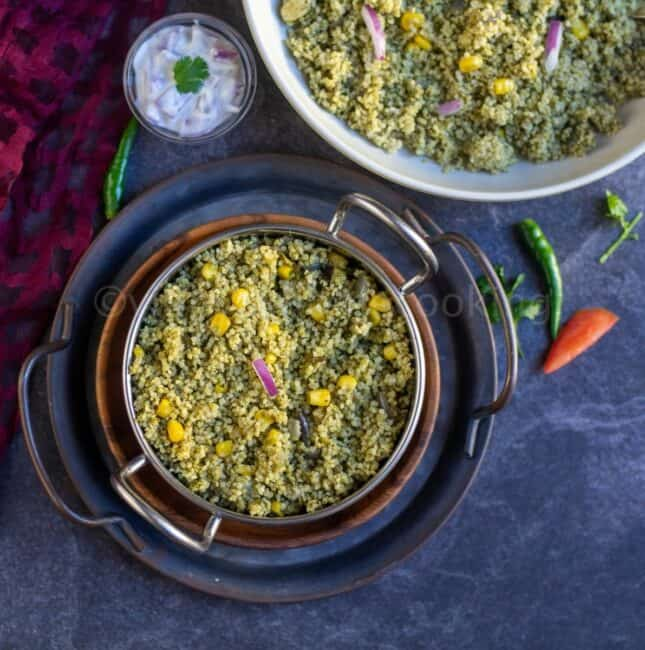 square image of millet palak pulao served on a kadai stacked on trays