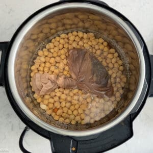 adding the soaked chipeas with potli into the instant pot