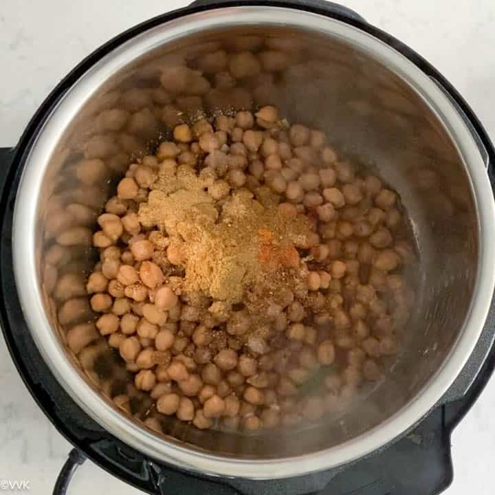 adding chickpeas and spices