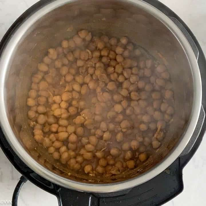 adding water to cook the chole