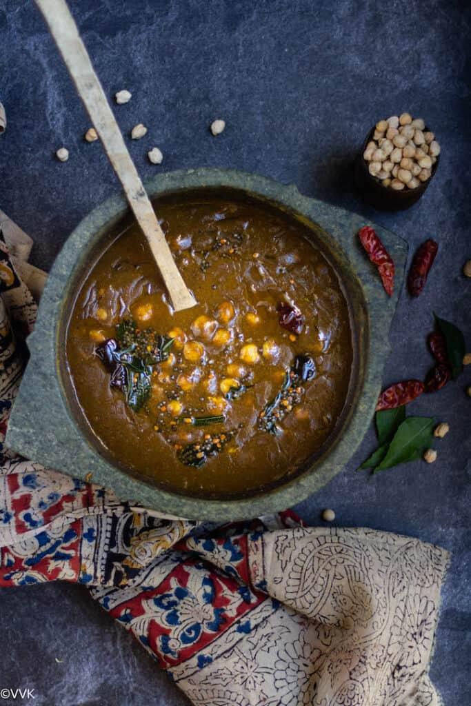 overhead shot of thanjavur style kadalai kuzhambu made in kalchatti