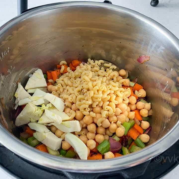 adding chickpeas and pasta