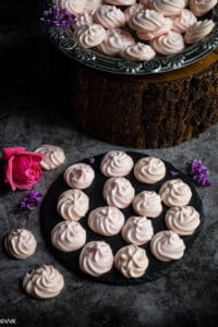 meringues placed on a black slate plate