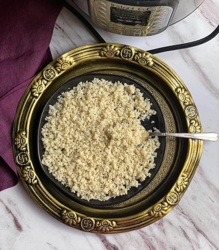 barnyard millet served with spoon in black plate