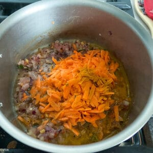 adding grated carrots