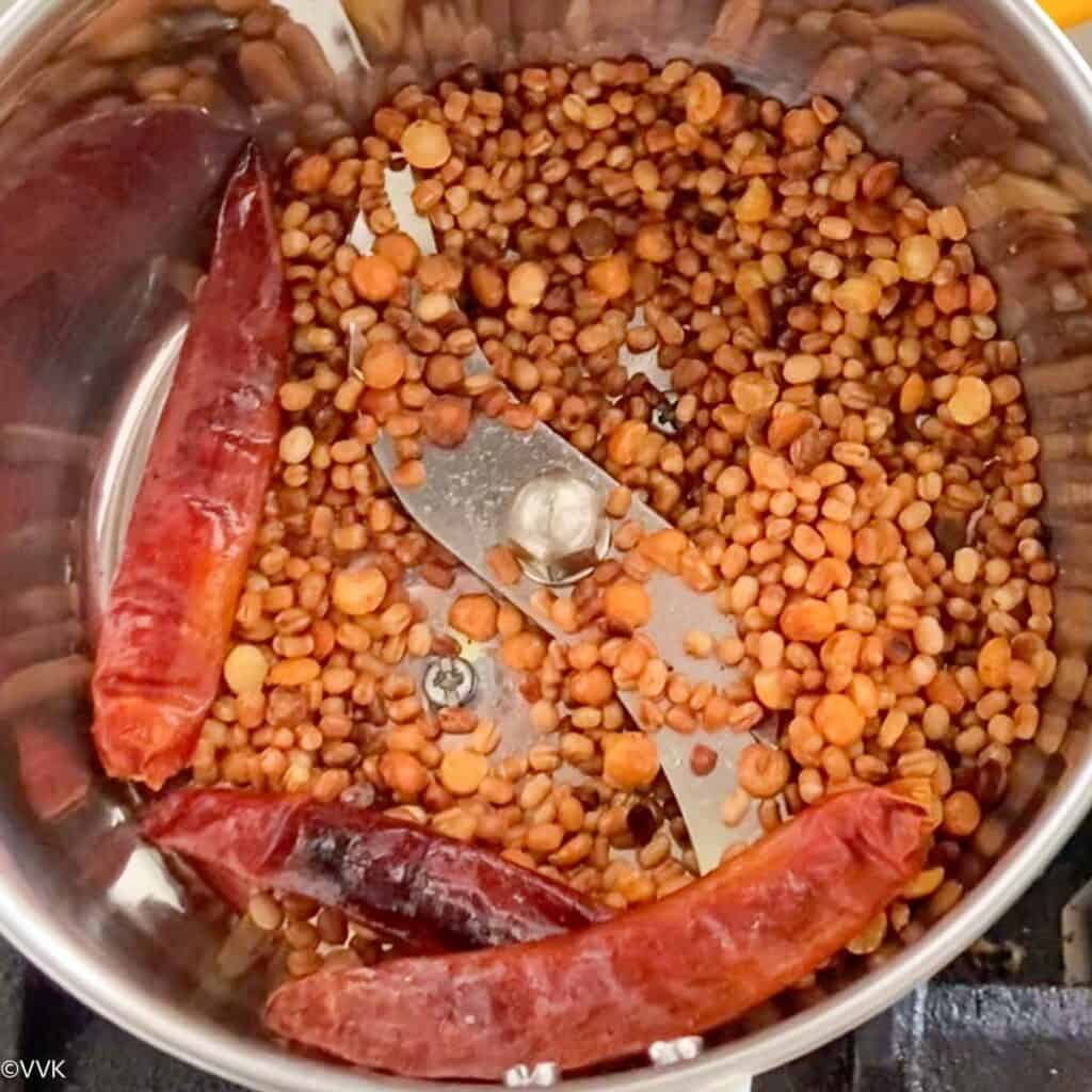 transferring the roasted lentils to a mixer jar