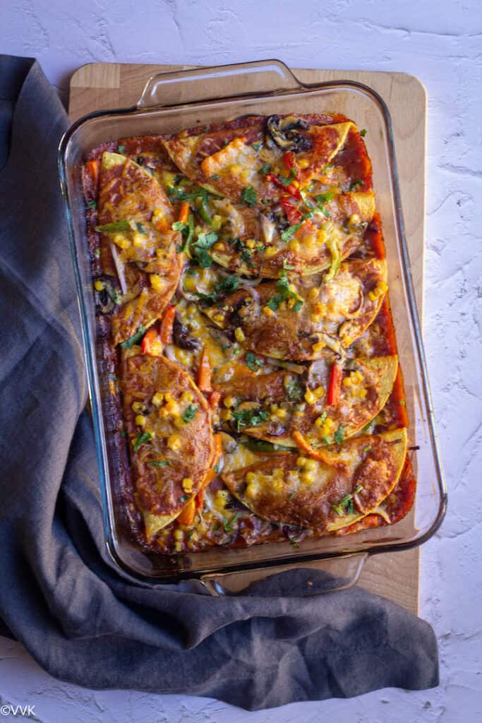Vegetarian enchilada casserole baked in a glassware dish