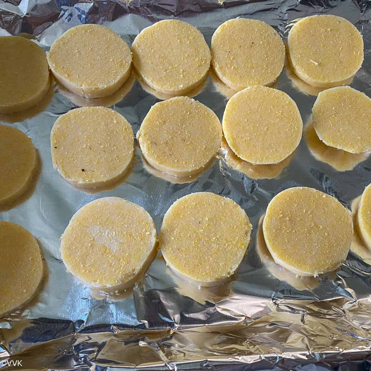 placing the sliced polenta on the baking tray
