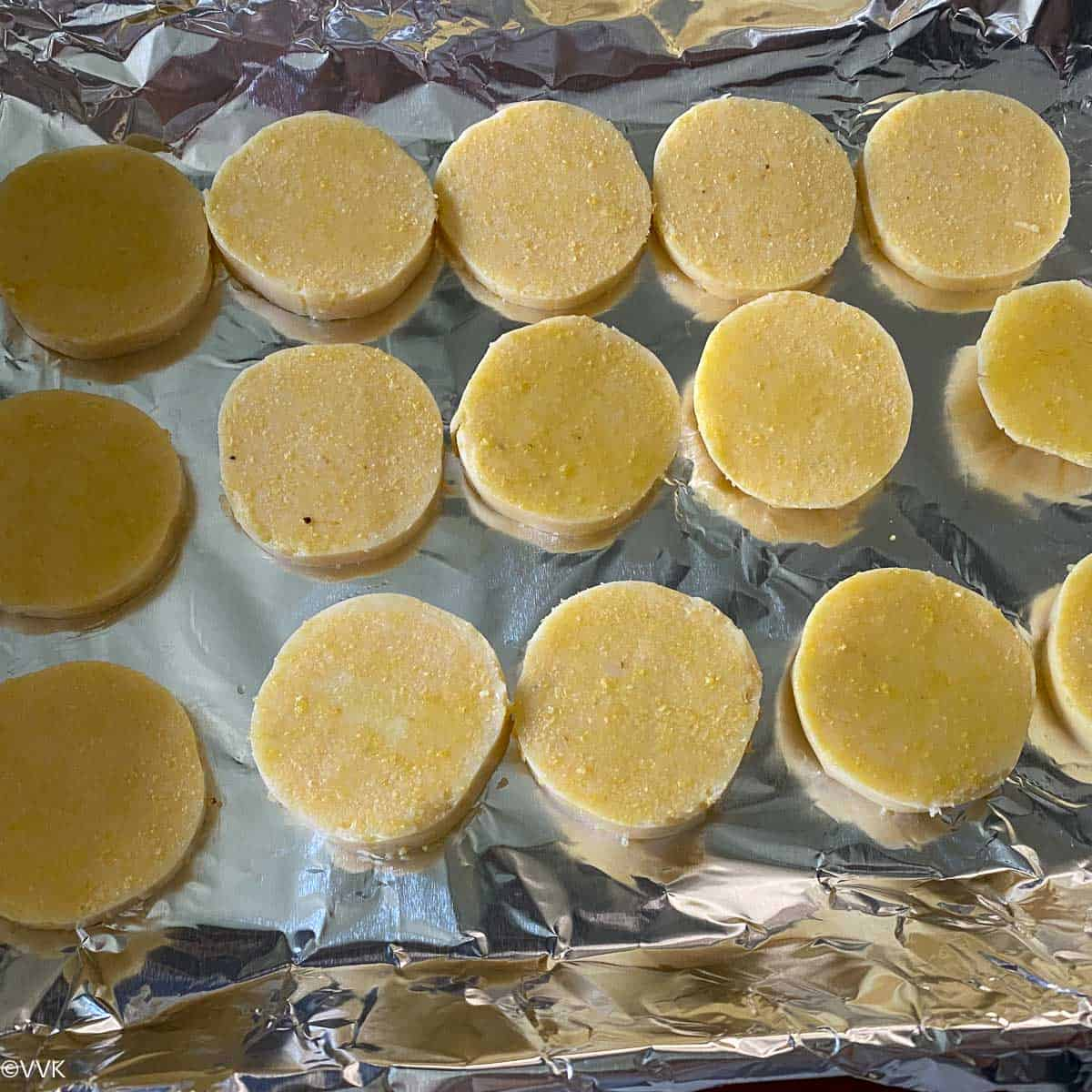 brushing the polenta with oil and baking