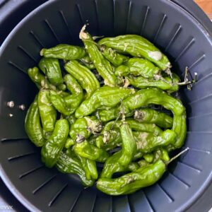 adding the peppers to the air fryer