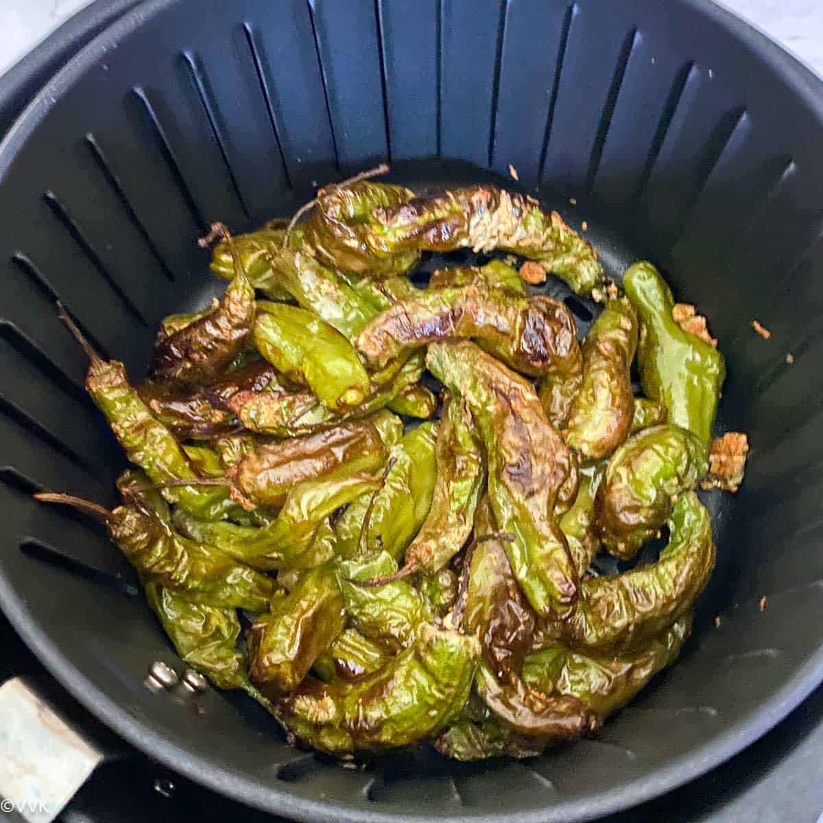 blistered and charred shishito peppers in the air fryer