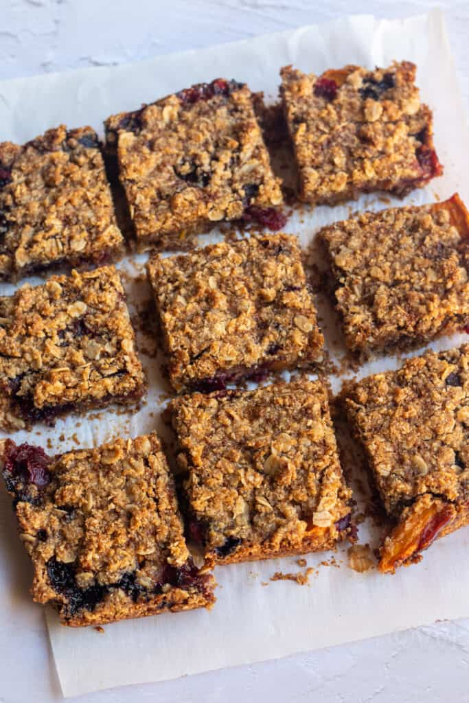 cut cherry mango crumble bars placed on a parchment paper