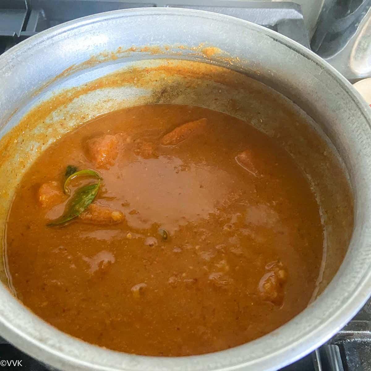 bringing the sambar to boil