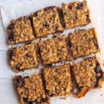 square image of crumble bars cut into 9 pieces