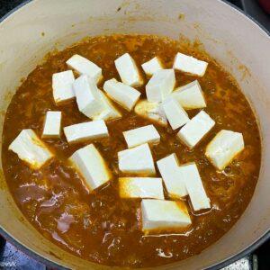 adding paneer into the gravy