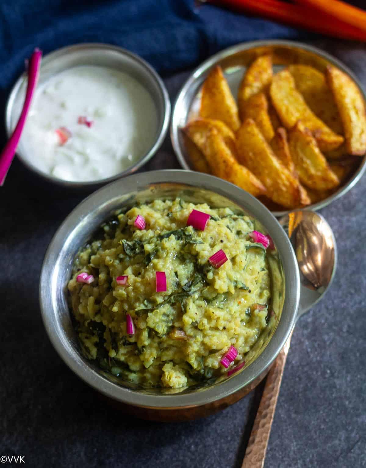 keerai kooty served in brassware served with potato and onion raita