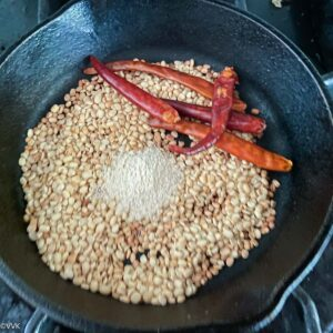 roasting urad dal and chilies