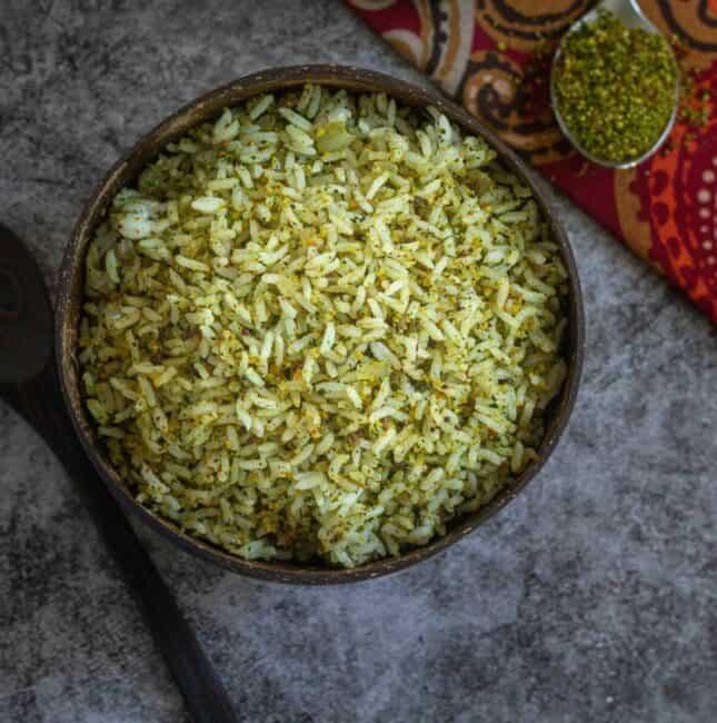 square image of cilantro rice served in coconut bowl