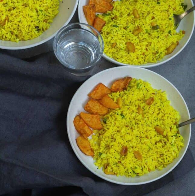 square image of lemon rice served with potato kari