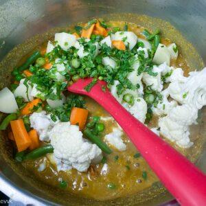 adding veggies for the kurma