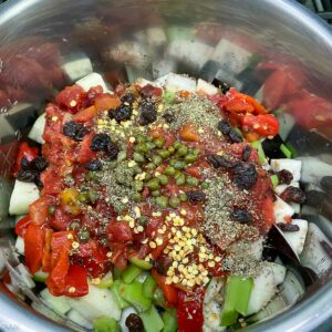 layering all the ingredients caponata ready to be cooked