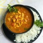 moroccan bean stew served in black bowl with rice